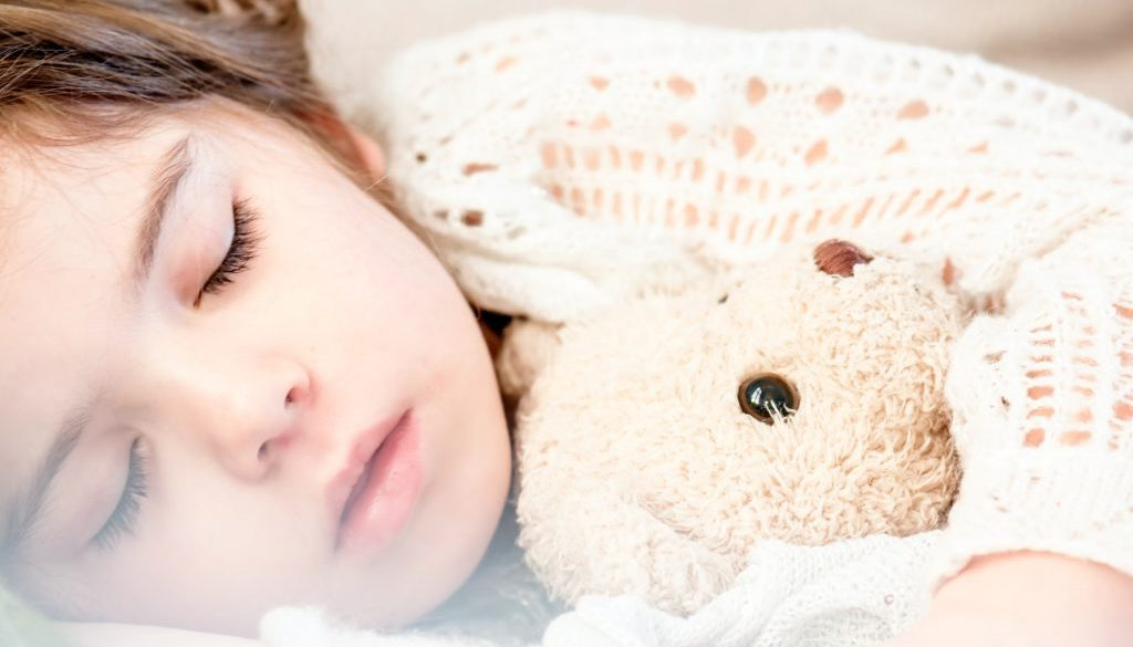 girl-sleeping-with-her-brown-plush-toy-101523